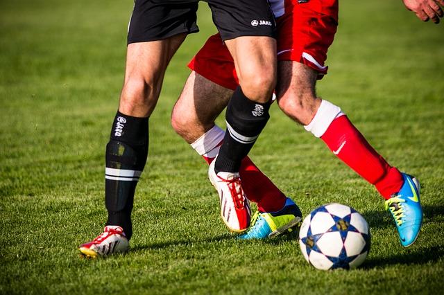 nohy fotbalistů